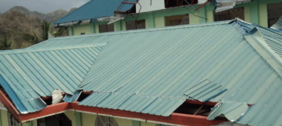 damage of gutter, roofings at the front view of mun. hall