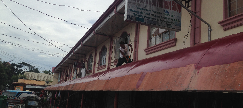 on-going painting of canopy in front of public market